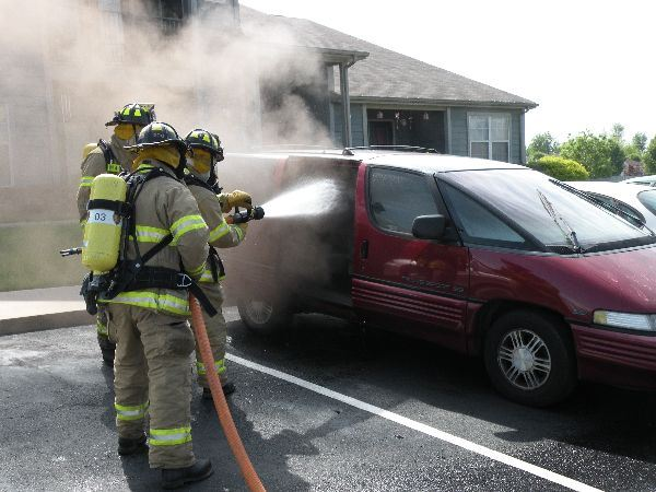 Firefighters Putting out Car Fire
